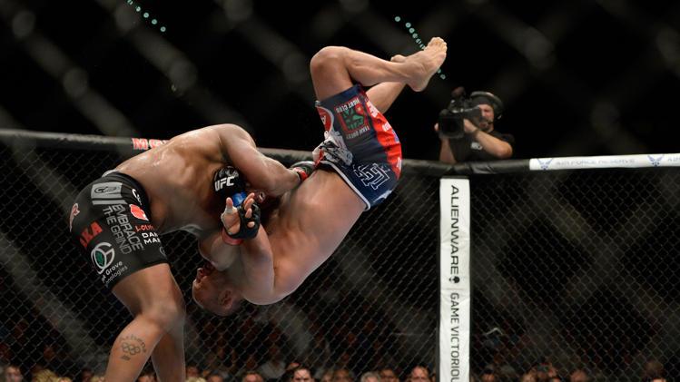 Daniel Cormier Rag Dolls Dan Henderson at UFC 173 .gif | MMA Nation